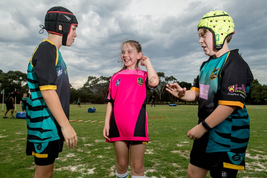 Jack Earney (left) Mia Johnson (centre) and Cooper Allan (right) are seen speaking during Eastern Raptors training.