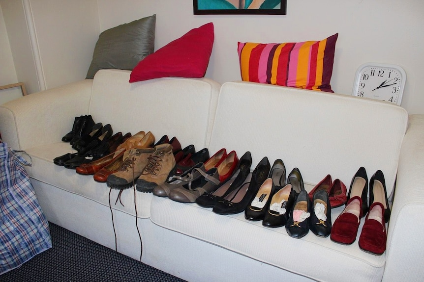 Shoes placed in a line on a couch