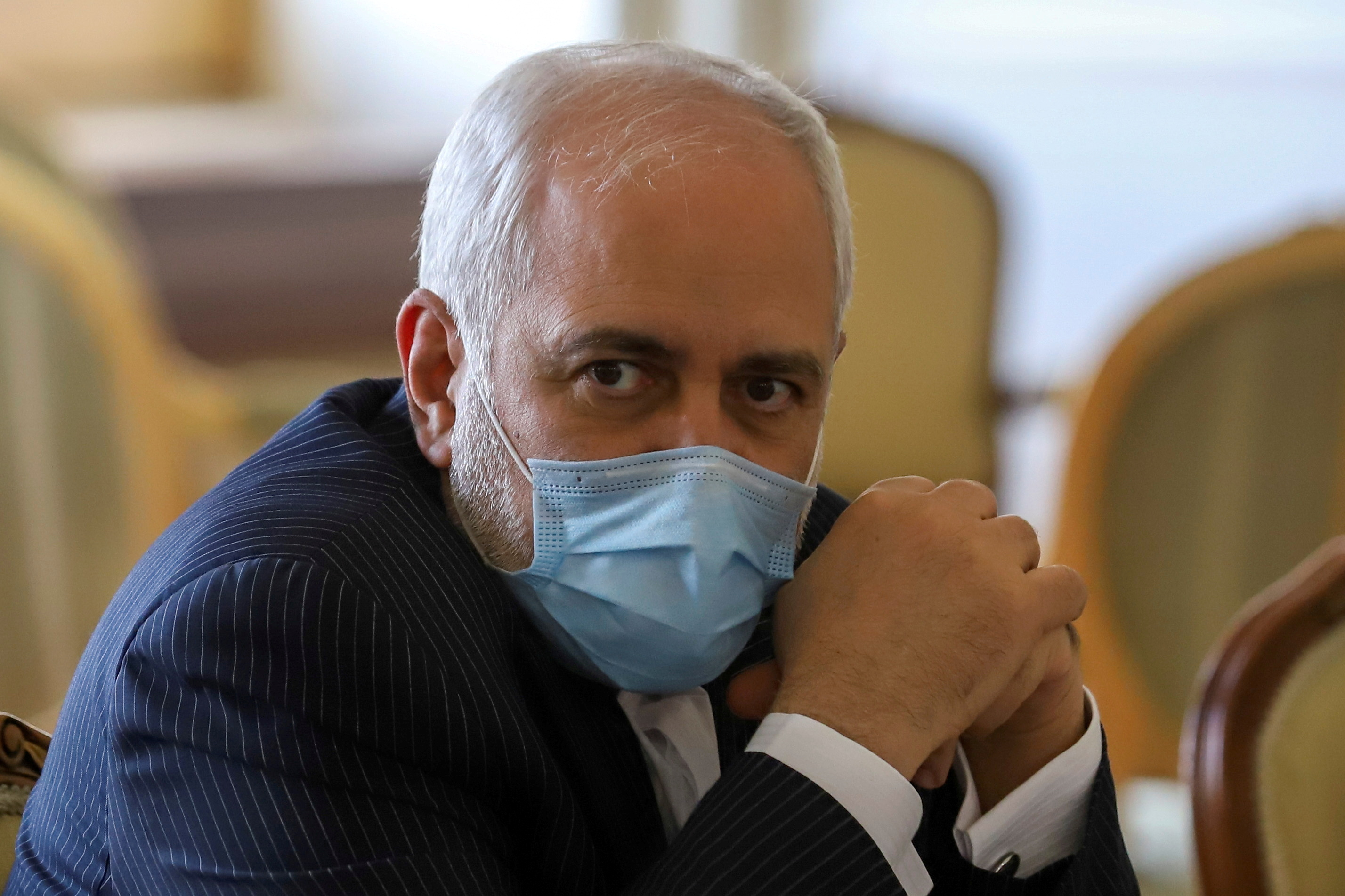 Iran's foreign minister looks on during a meeting in Tehran.