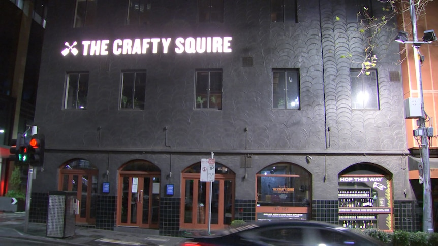 The Crafty Squire sign outside the pub at night.
