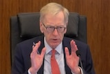 Commissioner Kenneth Hayne with hands outstretched at the banking and financial services royal commission