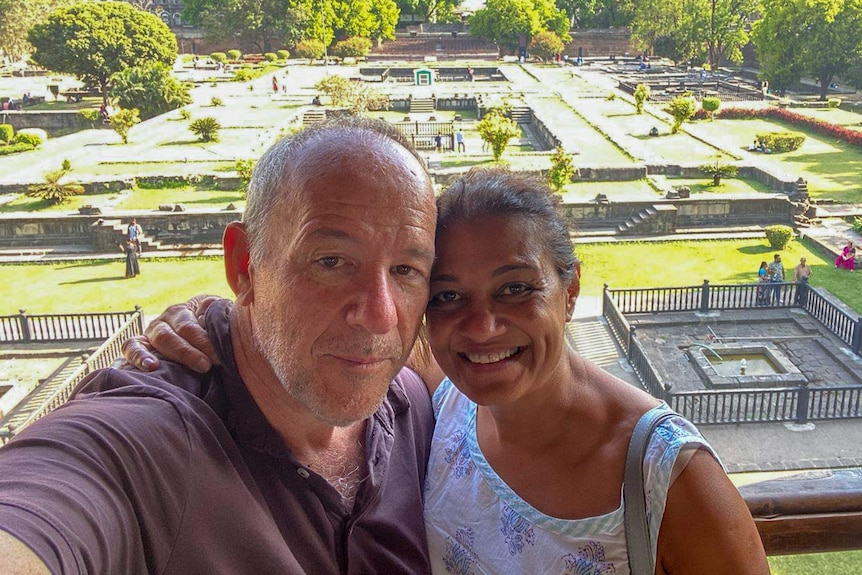 Brad Humphries and his wife Kunti Ranade embrace at a temple in India