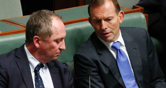 Barnaby Joyce and Tony Abbott talk to one another inside the House of Representatives.