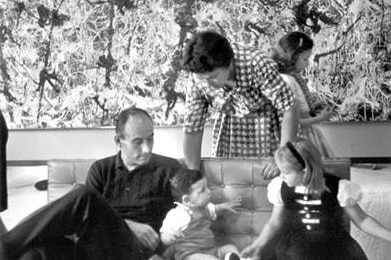 The Heller family sits in front of Blue Poles in their home.