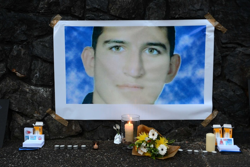 A shrine for Reza Barati is seen during a candlelight vigil in support of asylum seekers in Brisbane.