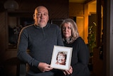 Sam and Suzanne Agnello holding a picture of their mother Carmela who died from COVID-19