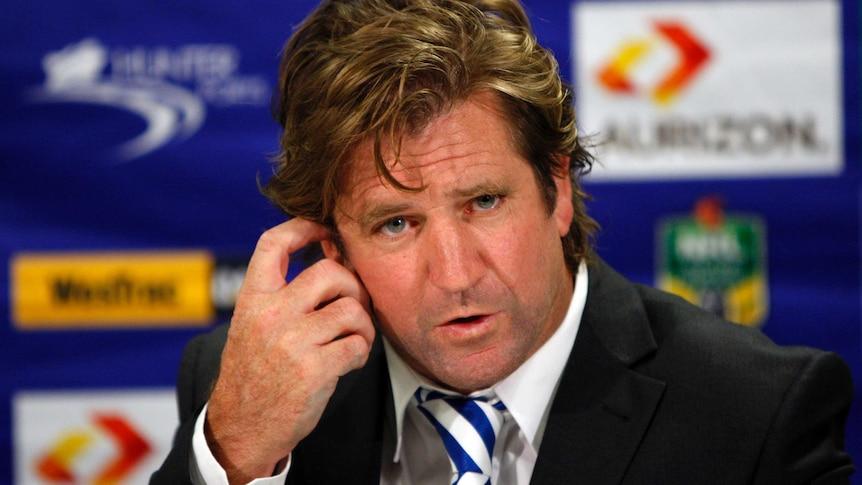 Des Hasler addresses the media after a game