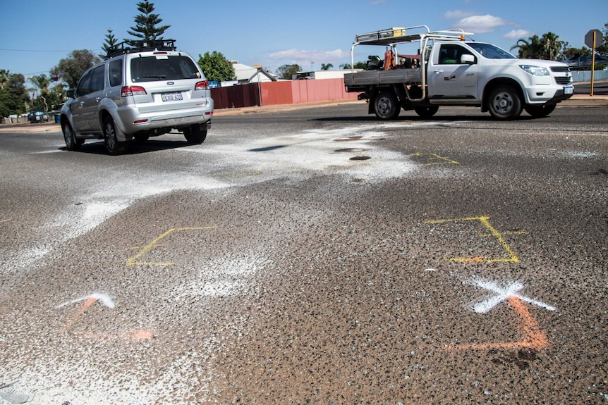 Chalk outlines on the road where the two cars collided.