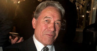 New Zealand First leader Winston Peters speaks to media on arrival at his election campaign party.
