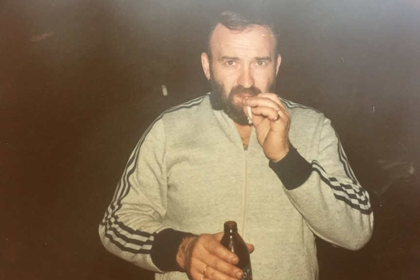 Peter Keogh in an old photograph, bearded and smoking a cigarette