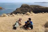 Aboriginal boys in Tasmania sit at taynayuwa