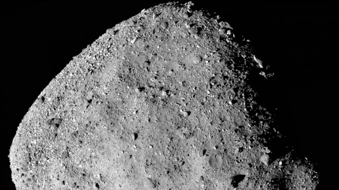 A closeup of a asteroid made of grey rock