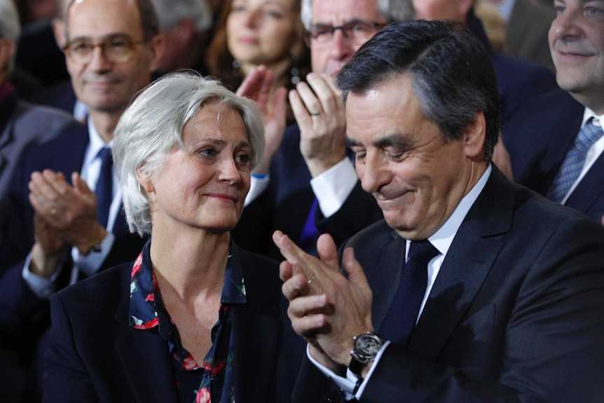 Conservative presidential candidate FrancoisFillonapplauds while his wife Penelope looks on, January 29 2017.