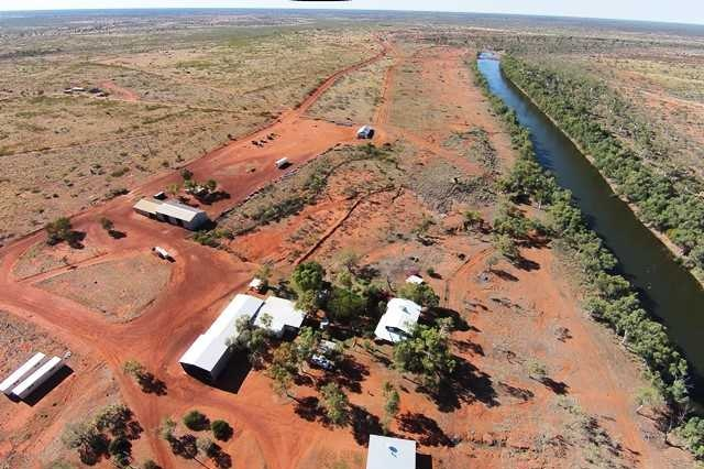 A cattle station homestead next to a river.