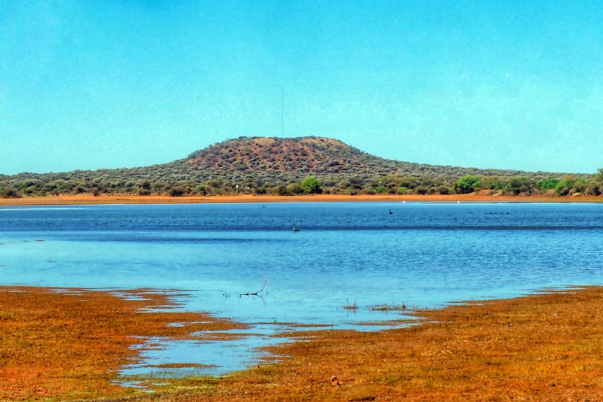 A dam surrounded by red dirt