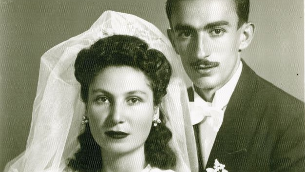 A historical black-and-white image of husband and wife Goar and Gevork Vartanyan dressed in wedding attire.
