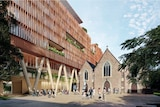 A concept image showing a large timber-facade building next to a heritage church