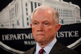 US Attorney General Jeff Sessions looks on during a news conference.