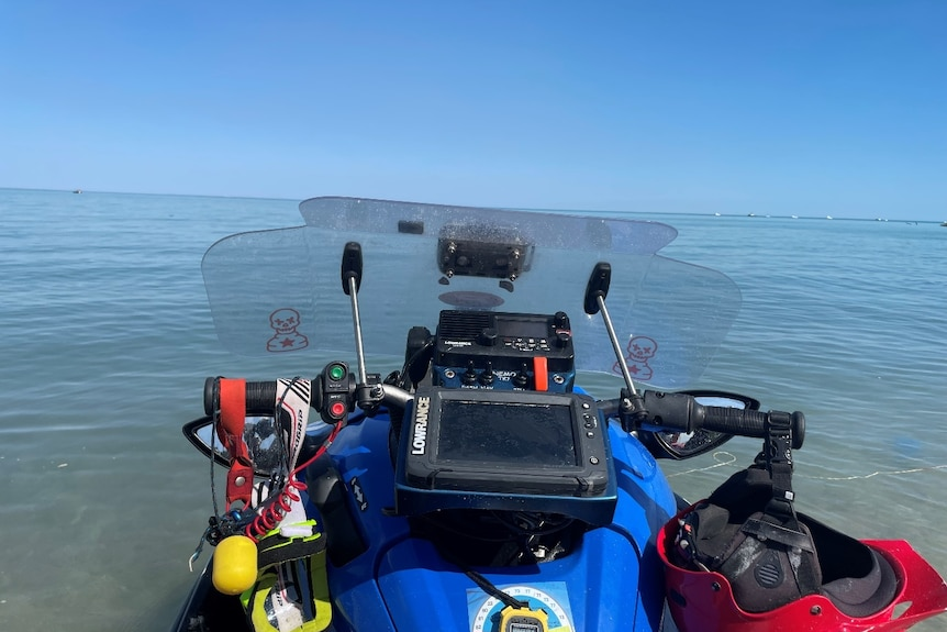 A jetski with a blue ocean in the background