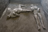 The casts of what are believed to have been a rich man and his male slave lay on the floor of an underground room.