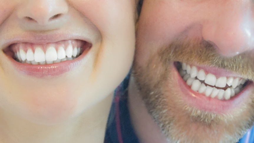Couple smiling with white teeth.
