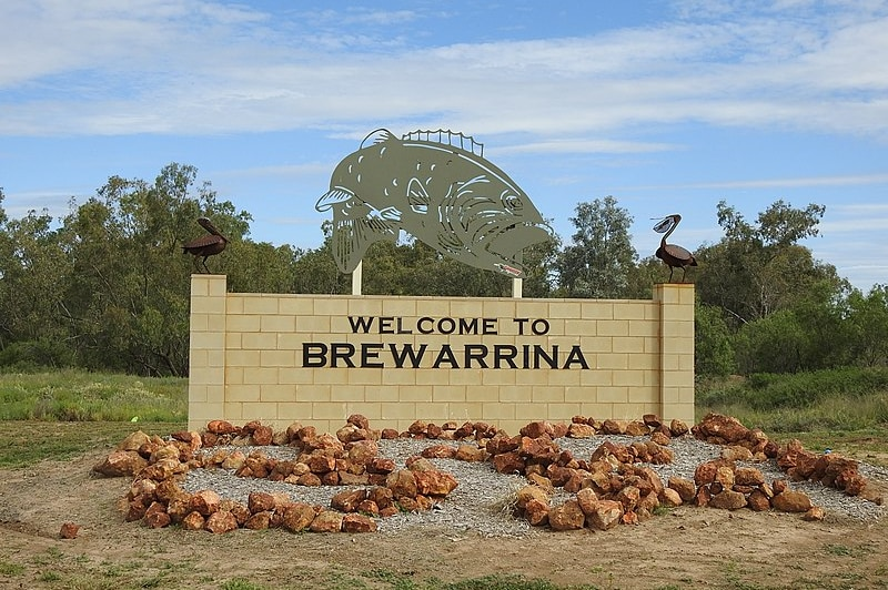Sign that says welcome to Brewarrina, Murray Cod sculpture on top of sign