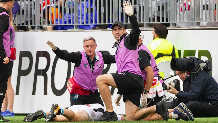 Robbie Gray of Port Adelaide is injured against Fremantle at Perth Stadium on July 15, 2018.