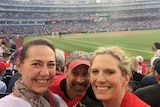 Lisa Millar with friends at a baseball game in the US.