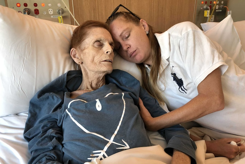 Cancer patient Josephine Collins with her daughter Amy Knowles on a cuddle bed in the Robina Hospital's palliative care ward.