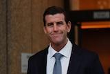 Ben Roberts-Smith smiles outside court