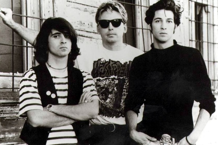 Three members of band Ratcat pose for a photo circa 1991.
