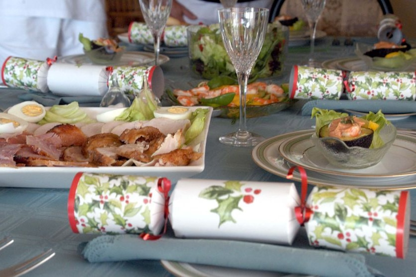 An 'Australian' Christmas lunch of cold meat, prawns and salad sits on a table