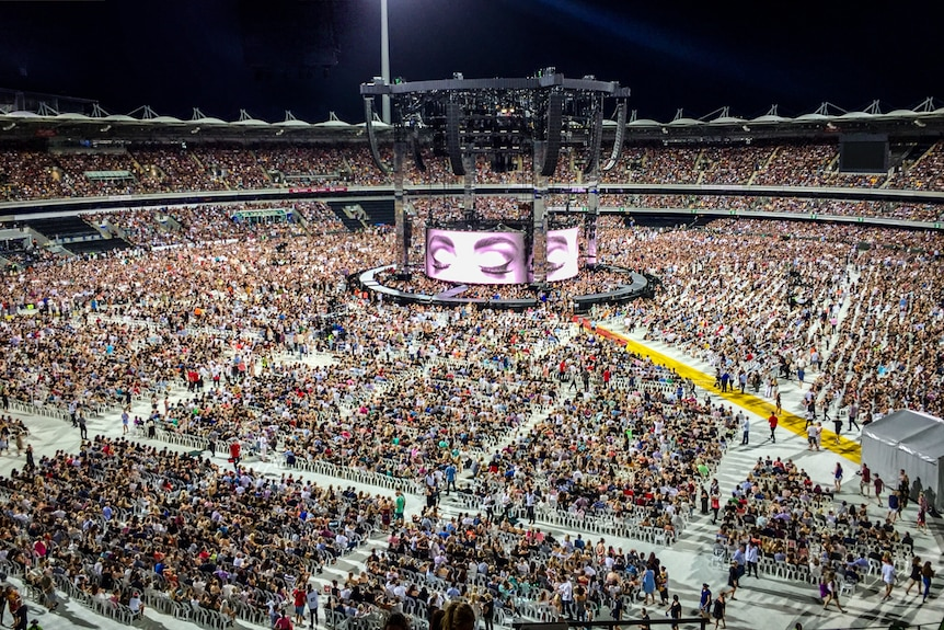 Fans clock to the Adele concert at The Gabba in Brisbane.