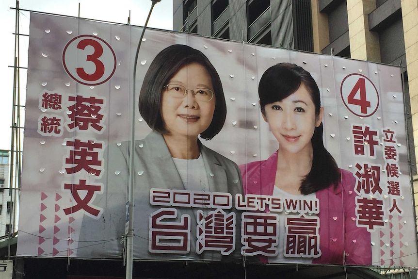Tsai Ing-wen and another candidate a sprawled across the side of a large building with the message '2020 let's win'