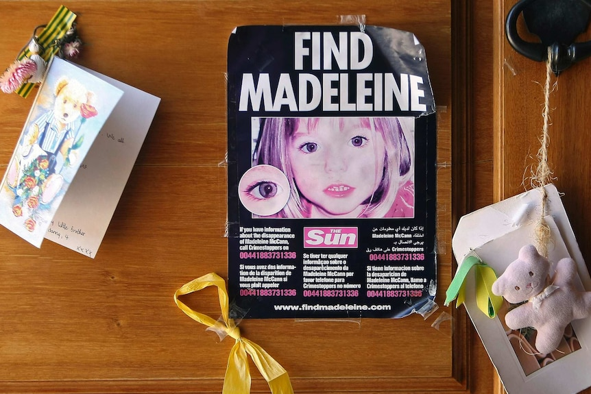 A poster with 'Find Madeleine' on it taped to a door with greeting cards and teddy bears stuck near it