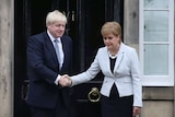 Scotland's First Minister Nicola Sturgeon shakes hands with Boris Johnson outside Bute House in Edinburgh, Scotland.