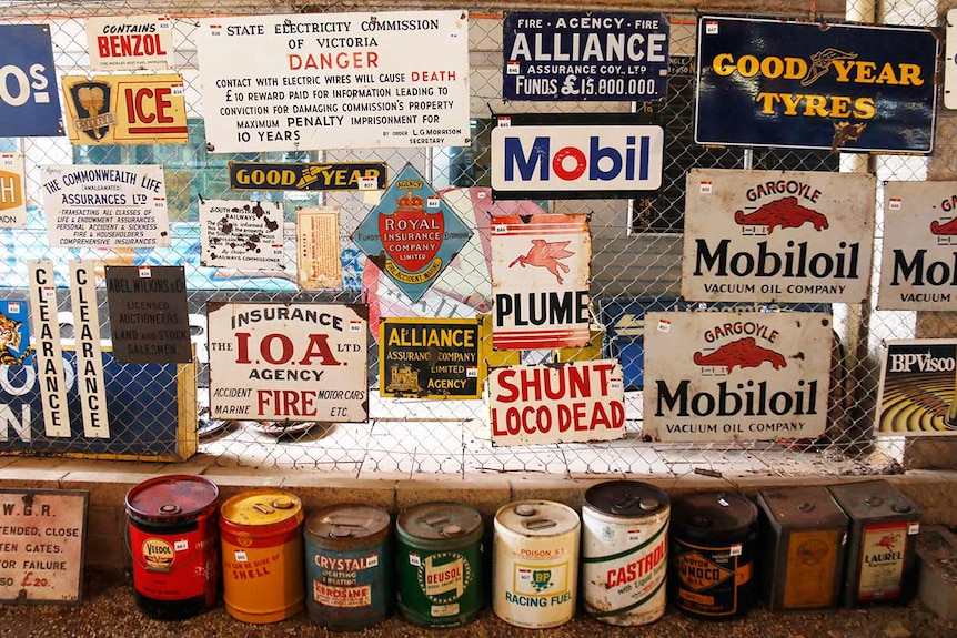 A wall covered in old signs.