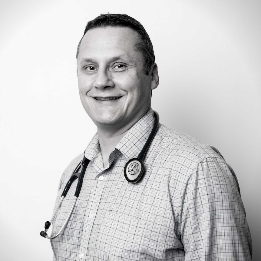 A smiling man with a stethoscope around his neck