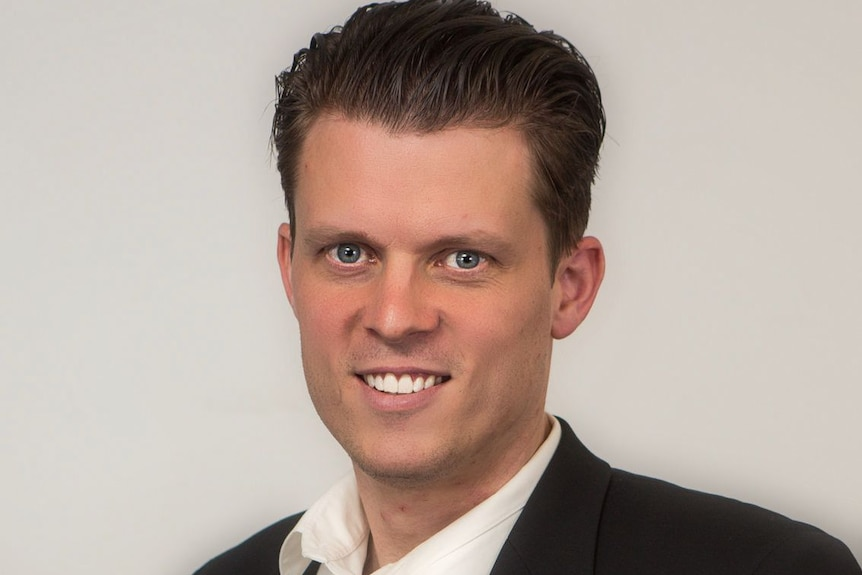 A profile picture of Dr Evan Shellshear in a suit