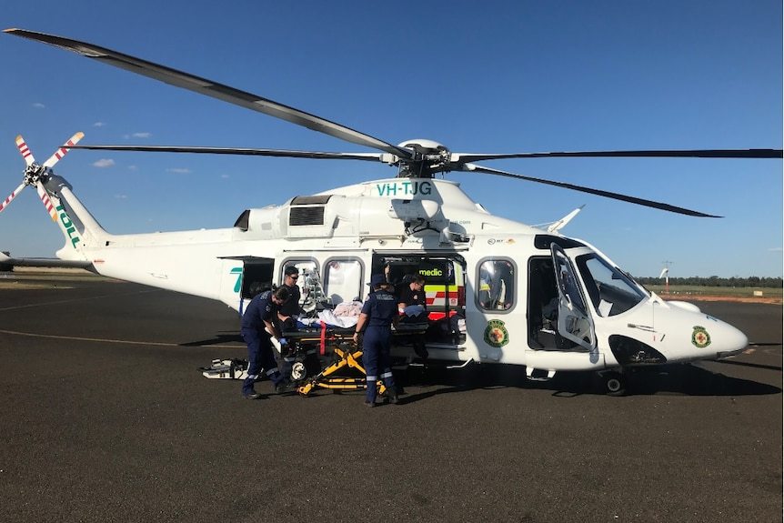 Children being put into a helicopter after a 'freak' jumping castle incident that left them with fractured bones.