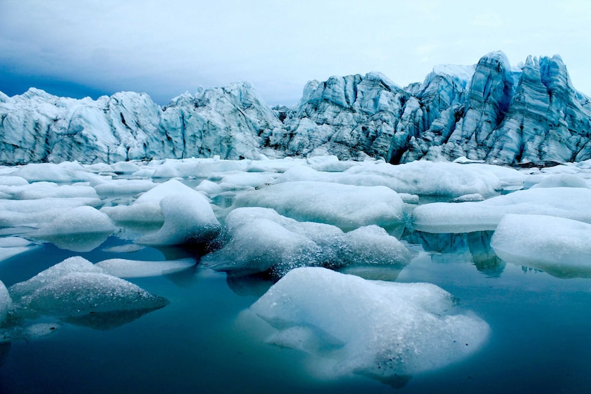 Melting ice in front of an ice berg.