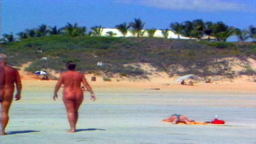 Two nudists walk on Cable Beach.