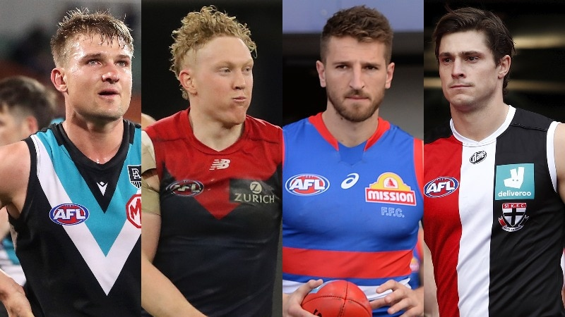 A composite photo of four AFL stars, the middle two holding footballs in their hands.