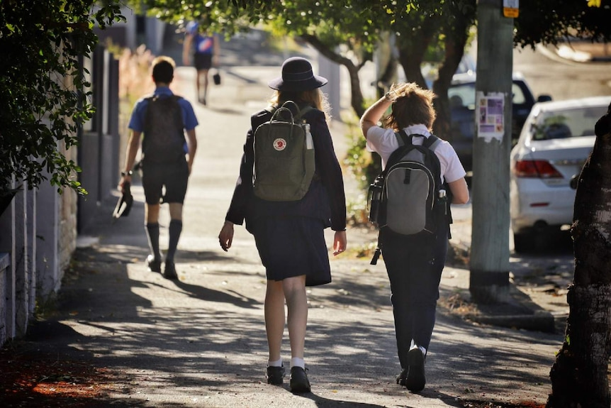 Secondary School Students walking to school.