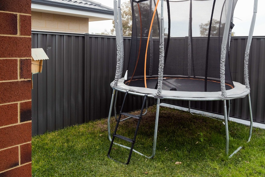 A trampoline in Angie and Gilbert Tsuro's backyard.