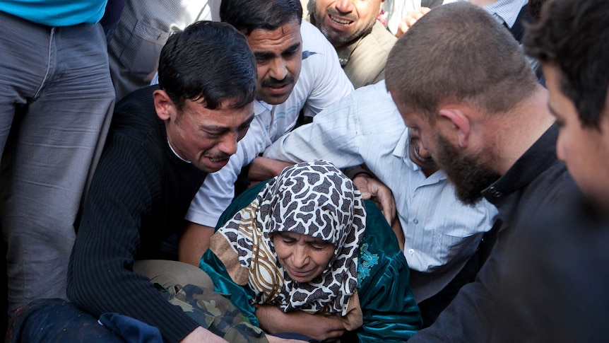 A mother mourns the death of her son in Syria