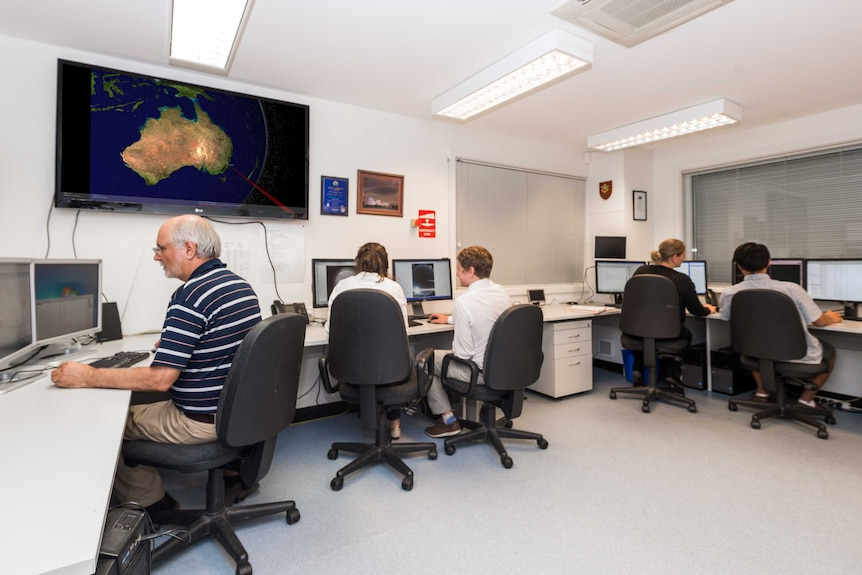 Scientists sitting at computers.