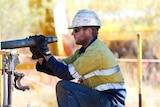 A mine worker on an exploration drill in the Pilbara, WA