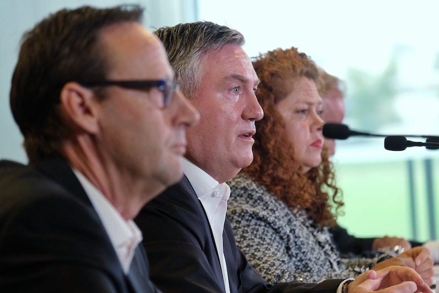 Mark Anderson, Eddie McGuire and Jodie Sizer sit in a line, speaking at a press conference