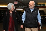 Alan and Judy Gross walk through a parking garage after arriving for a news conference at a law firm in Washington December 17, 2014